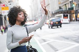Woman-Hails-Ridesharing-Service